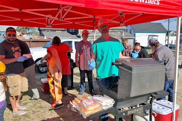 Queen General Hospital doctors serve the community – by cooking hot dogs!